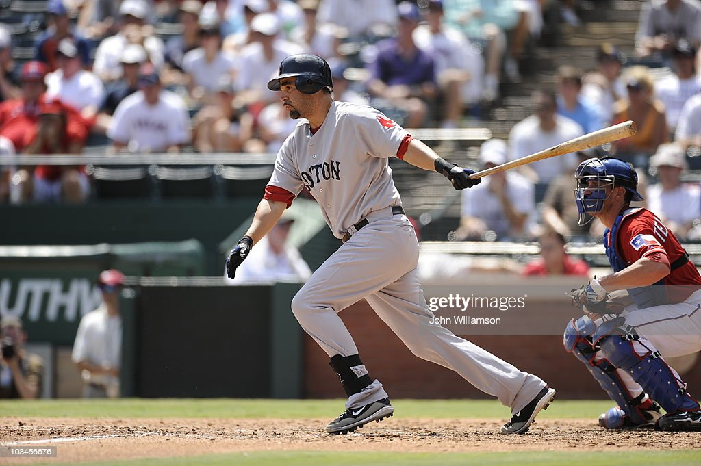 Designated hitter Mike Lowell of the Boston Red Sox bats during the game against the Texas Rangers at Rangers Ballpark in Arlington August 15 2010 in...