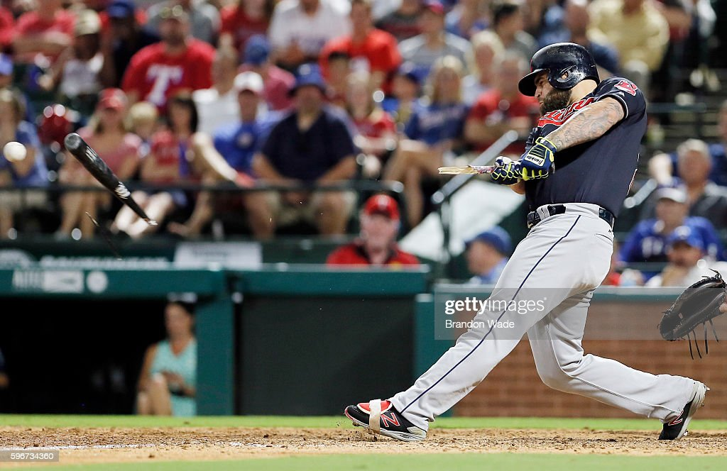 Designated hitter Mike Napoli of the Cleveland Indians breaks his bat during the sixth inning of a baseball game against the Texas Rangers at Globe...