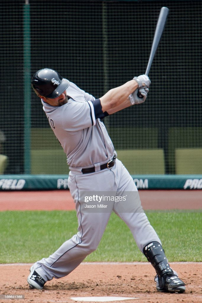 Designated hitter <a gi-track='captionPersonalityLinkClicked' href=/galleries/search?phrase=Paul+Konerko&family=editorial&specificpeople=203327 ng-click='$event.stopPropagation()'>Paul Konerko</a> #14 of the Chicago White Sox hits a two run home run during the sixth inning against the Cleveland Indians at Progressive Field on April 14, 2013 in Cleveland, Ohio. The White Sox defeated the Indians 3-1.
