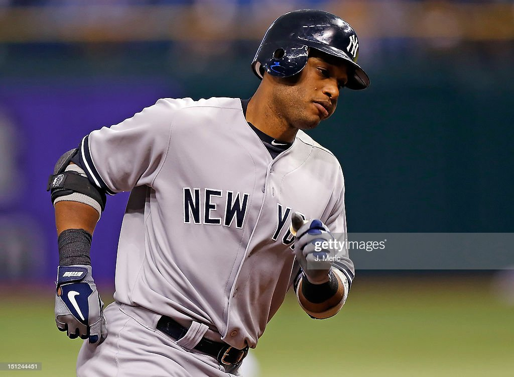 Designated hitter Robinson Cano #24 of the New York Yankees rounds the bases after his home run against the Tampa Bay Rays during the game at Tropicana Field on September 4, 2012 in St. Petersburg, Florida.