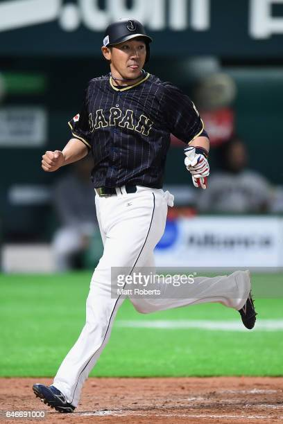 Designated hitter Seiichi Uchikawa of Japan scores a run by the grounder hit by Seiji Kobayashi in the top of the seventh inning during the SAMURAI...