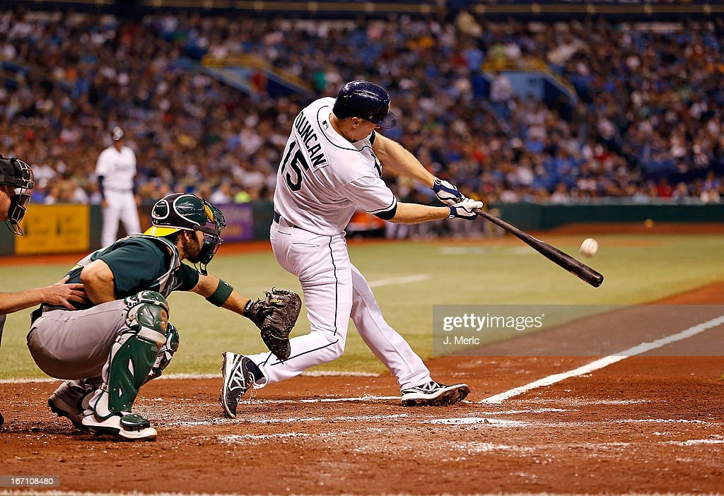 Designated hitter <a gi-track='captionPersonalityLinkClicked' href=/galleries/search?phrase=Shelley+Duncan&family=editorial&specificpeople=3906612 ng-click='$event.stopPropagation()'>Shelley Duncan</a> #15 of the Tampa Bay Rays fouls off a pitch against the Oakland Athletics during the game at Tropicana Field on April 20, 2013 in St. Petersburg, Florida.