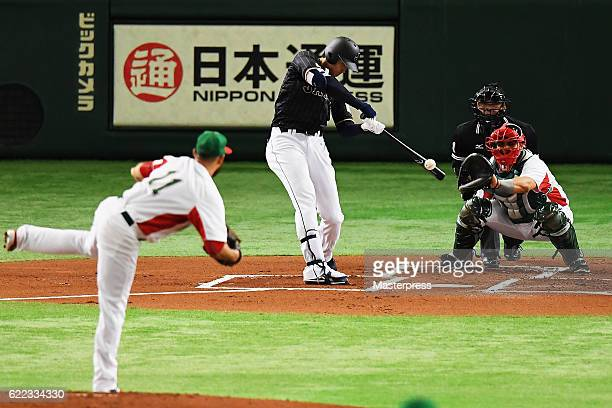 Designated hitter Shohei Ohtani of Japan hits a double in the first inning during the international friendly match between Mexico and Japan at the...