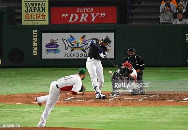 Designated hitter Shohei Ohtani of Japan hits an infield single in the fifth inning during the international friendly match between Mexico and Japan...