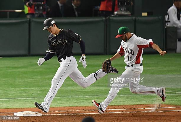 Designated hitter Shohei Ohtani of Japan runs to the first base to hit an infield single in the fifth inning during the international friendly match...