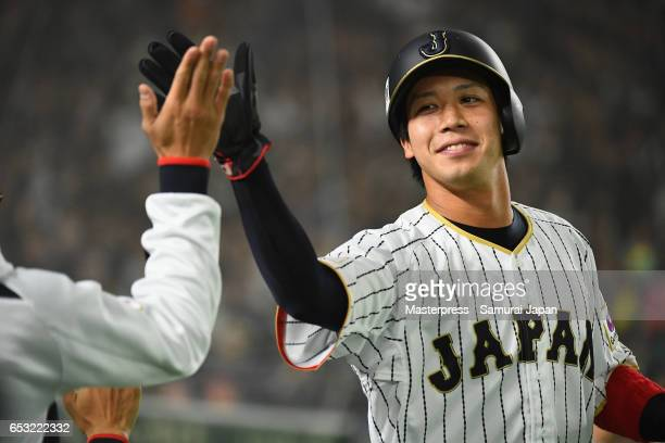 Designated hitter Tetsuto Yamada of Japan celebrates after scoring a run to make it 44 after a RBI single of Outfielder Yoshitomo Tsutsugoh in the...