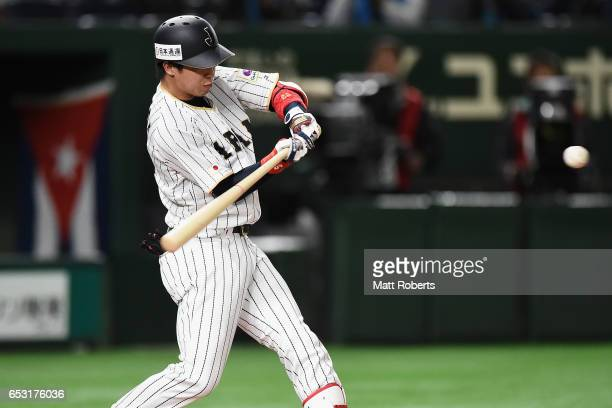 Designated hitter Tetsuto Yamada of Japan hits a double in the bottom of the third inning during the World Baseball Classic Pool E Game Four between...