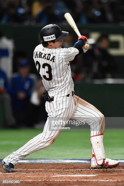 Designated hitter Tetsuto Yamada of Japan hits a single in the bottom of the third inning during the World Baseball Classic Pool E Game Six between...
