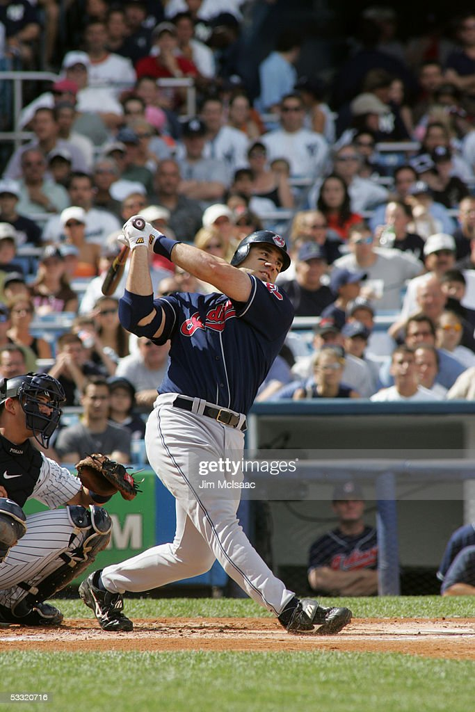 Designated hitter Travis Hafner of the Cleveland Indians swings at a New York Yankees pitch during the game on July 9 2005 at Yankee Stadium in the...