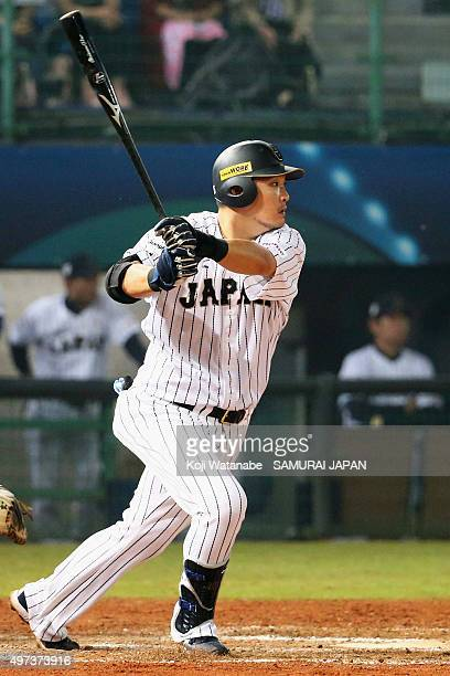 Designated hitter Yoshitomo Tsutsugo of Japan hits a single in the bottom of eighth inning during the WBSC Premier 12 quarter final match between...