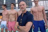 Designer Adam Brown poses with models at Orlebar Brown presents the Spring/Summer 2017 Collection in partnership with Bold New York and Lifetime...
