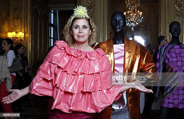 Designer Agatha Ruiz de la Prada poses with dresses from her collection during a exhibition at Spanish embassy on April 15 2015 in Paris France