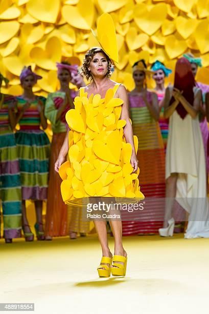 Designer Agatha Ruiz de la Prada walks the runway after her show during the MercedesBenz Fashion Week Madrid Spring/Summer 2016 at Ifema on September...