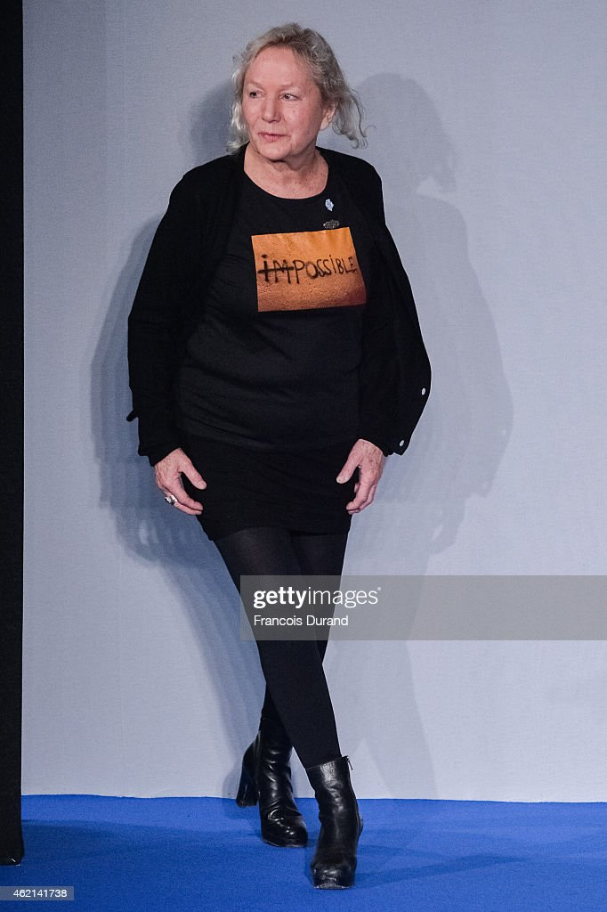 Designer Agnes B acknowledges the audience during the Agnes B. Menswear Fall/Winter 2015-2016 show as part of Paris Fashion Week on January 25, 2015 in Paris, France.