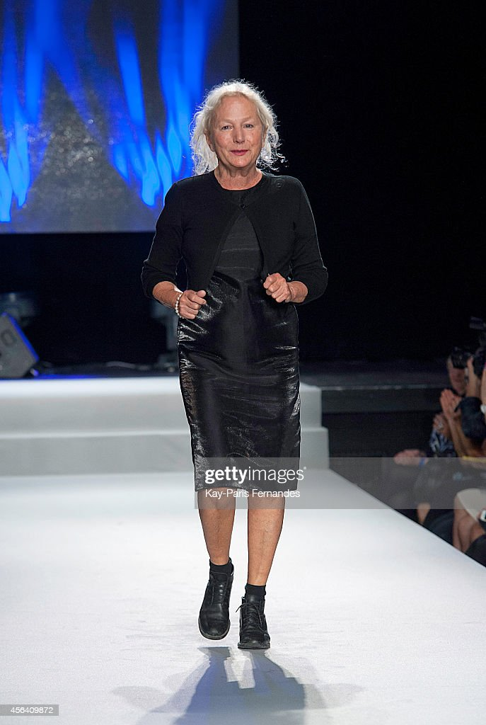 Designer Agnes B walks the runway during the Agnes B show as part of the Paris Fashion Week Womenswear Spring/Summer 2015 on September 30, 2014 in Paris, France.
