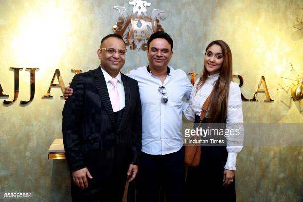 Designer Ajjay Mehrra and Nikhil Anand and Vibhuti Anand during the launch of a new menswear store at South Extension 1 on October 2 2017 in New...