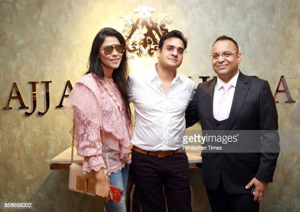 Designer Ajjay Mehrra and Ritesh Gupta and Shuchi Gupta during the launch of a new menswear store at South Extension 1 on October 2 2017 in New Delhi...