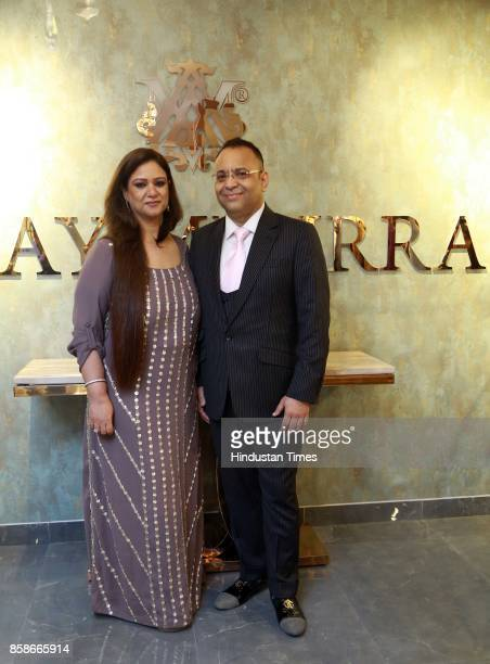 Designer Ajjay Mehrra and Ssunita Mehrra during the launch of a new menswear store at South Extension 1 on October 2 2017 in New Delhi India The...