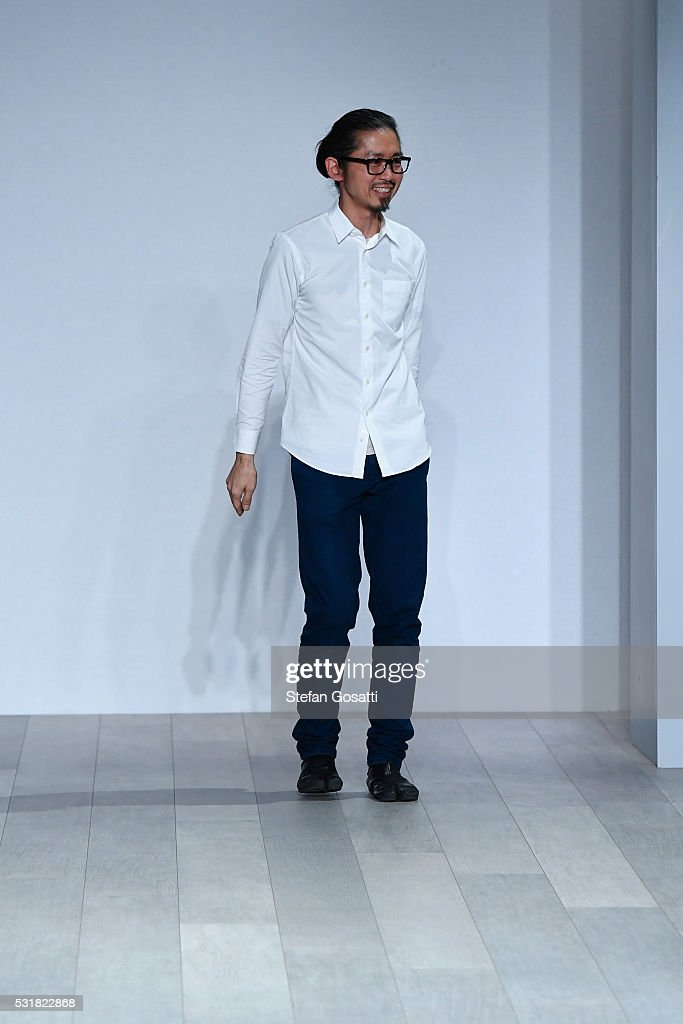 Designer Akira Isogawa acknowledges the crowd from the runway during the Akira show at MercedesBenz Fashion Week Resort 17 Collections at...