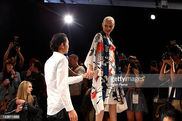 Designer Akira Isogawa on stage with models during the show by Akira on day five of Mercedes Benz Fashion Week Australia Spring/Summer 2012/13 at the...