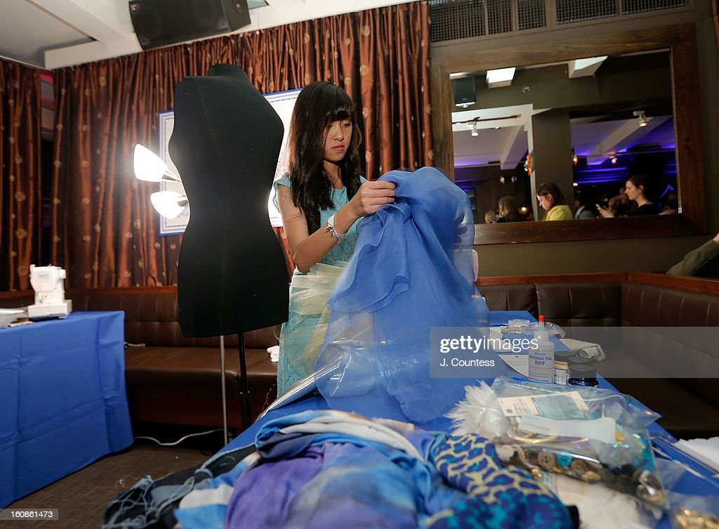 Designer Alaina Thai works on her design during the Aquafina 'Pure Challenge' at the Aquafina 'Pure Challenge' After Party at The Empire Hotel Rooftop on February 6, 2013 in New York City.