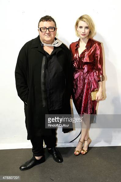 Designer Alber Elbaz and actress Emma Roberts attend the Lanvin show as part of the Paris Fashion Week Womenswear Fall/Winter 20142015 on February 27...