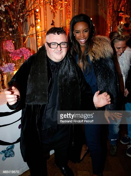 Designer Alber Elbaz and Kelly Rowland attend the Swarovski X Lanvin Cocktail Party at ShangriLa Hotel Paris on March 6 2015 in Paris France
