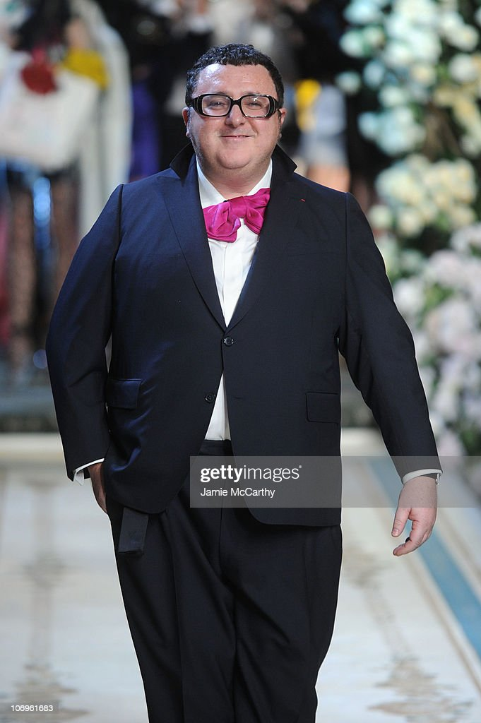 Designer <a gi-track='captionPersonalityLinkClicked' href=/galleries/search?phrase=Alber+Elbaz&family=editorial&specificpeople=783481 ng-click='$event.stopPropagation()'>Alber Elbaz</a> walks the runway during the Lanvin for H&M Haute Couture Show at The Pierre Hotel on November 18, 2010 in New York City.