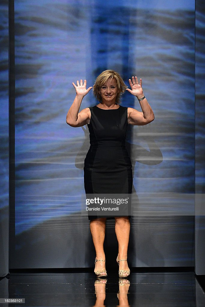 Designer Alberta Ferretti acknowledges the applause of the public after the Alberta Ferretti Spring/Summer 2013 fashion show as part of Milan...