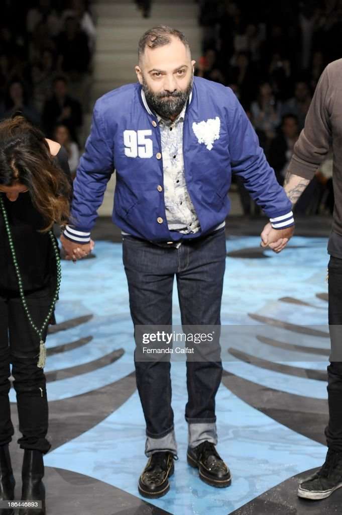Designer Alberto Hiar walks the runway at the Cavalera show at Sao Paulo Fashion Week Winter 2014 on October 30, 2013 in Sao Paulo, Brazil.