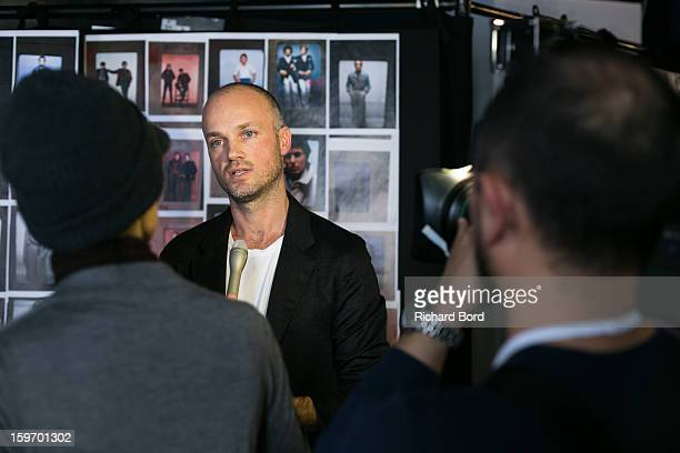Designer Aldo Maria Camillo speaks to media backstage before the Cerruti Men Autumn / Winter 2013 show as part of Paris Fashion Week on January 18...