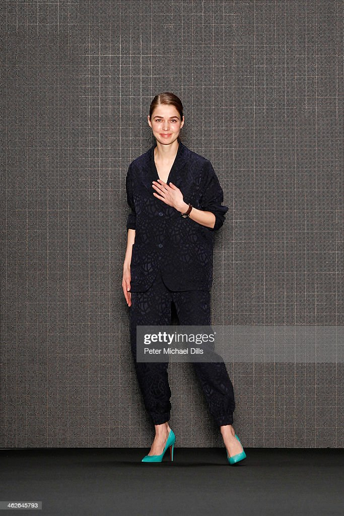 Designer Alena Akhmadullina appears at the end of the runway at the Alena Akhmadullina - presented by Mercedes-Benz and ELLE Backstage show during Mercedes-Benz Fashion Week Autumn/Winter 2014/15 at Brandenburg Gate on January 14, 2014 in Berlin, Germany.
