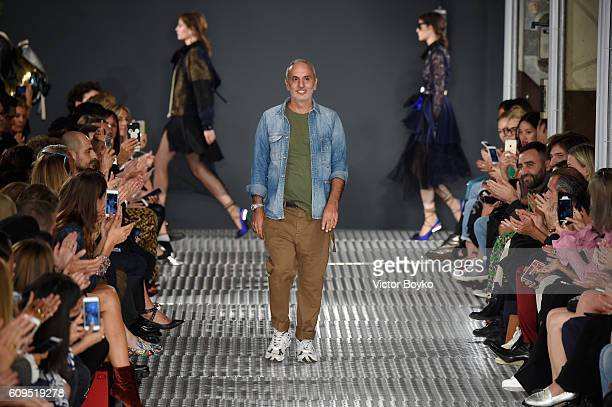 Designer Alessandro Dell'Acqua acknowledges the applause of the audience after the Fay show during Milan Fashion Week Spring/Summer 2017 on September...