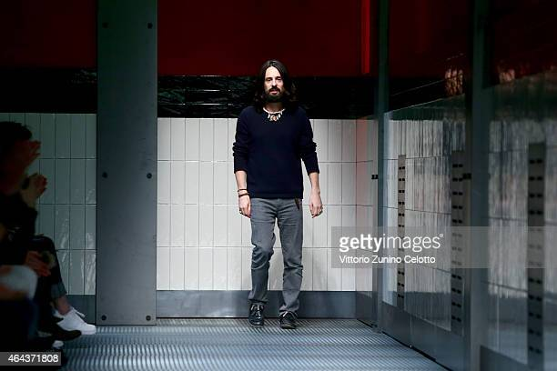 Designer Alessandro Michele acknowledges the applause of the audience after the Gucci show during the Milan Fashion Week Autumn/Winter 2015 on...
