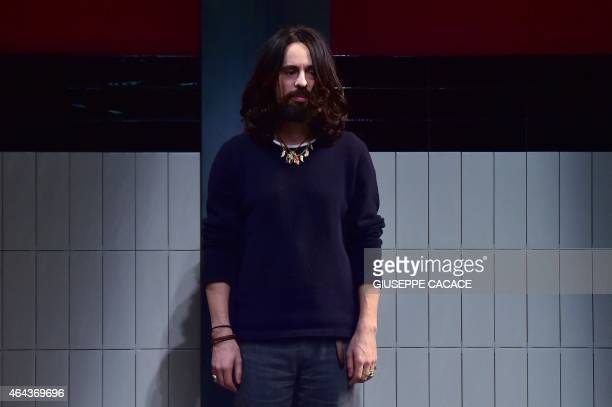 Designer Alessandro Michele acknowledges the audience following the Gucci show at the women Fall / Winter 2015/16 Milan's Fashion Week on February 25...