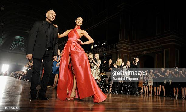 Designer Alex Perry and Megan Gale showcases a design by Alex Perry as part of the LMFF Red Carpet runway show on day three of the 2011 L'Oreal...