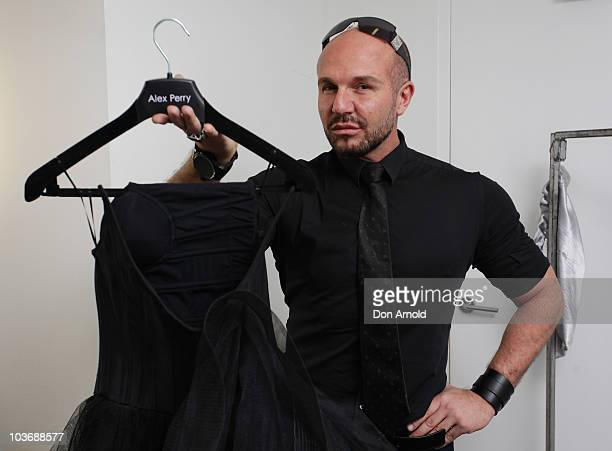 Designer Alex Perry poses backstage ahead of the Alex Perry catwalk show as part of Rosemount Sydney Fashion Festival 2010 at Sydney Town Hall on...