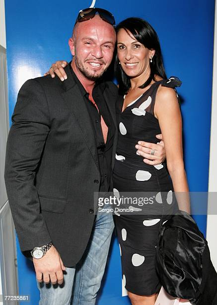 Designer Alex Perry poses with his his wife Mary Perry after his catwalk show on the first day of Rosemount Australian Fashion Week's Transeasonal...