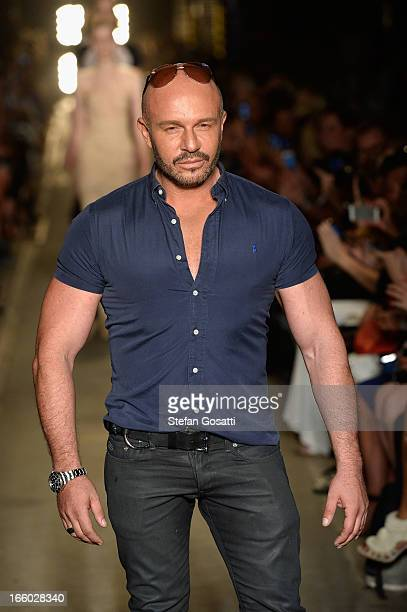 Designer Alex Perry walks the runway after the Alex Perry show during MercedesBenz Fashion Week Australia Spring/Summer 2013/14 at Carriageworks on...