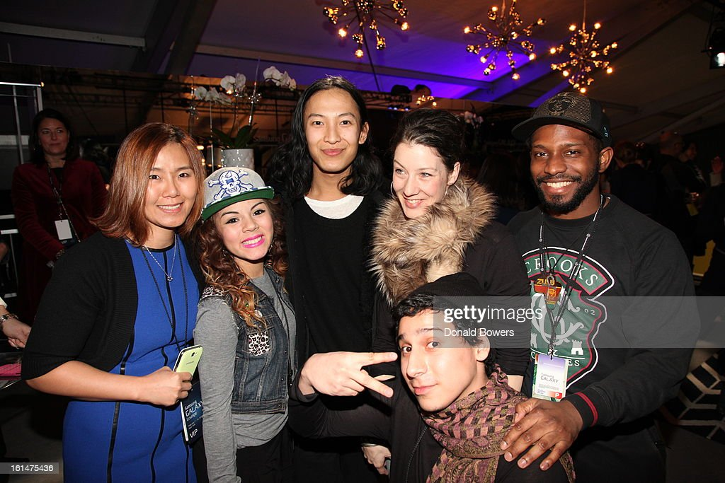 Designer Alexander Wang, Christine Cho of Samsung and Art Smart participants attend the Alexander Wang reception at the Samsung Galaxy Lounge with Art Start At Mercedes-Benz Fashion Week Fall 2013 Collections at Lincoln Center on February 10, 2013 in New York City.