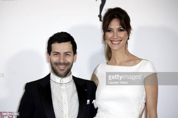 Designer Alexis Mabille and Miss France 1999 Mareva Galanter attend 'Les Bonnes Fees' Charity Gala at Hotel D'Evreux on March 20 2017 in Paris France