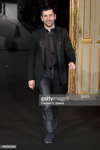 Designer Alexis Mabille appears on the catwalk after presenting the Alexis Mabille show as part of Paris Fashion Week Haute Couture Spring/Summer...
