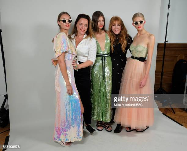 Designer Alice Temperley and Charlotte Tilbury pose with models backstage following the Temperley London show during London Fashion Week September...