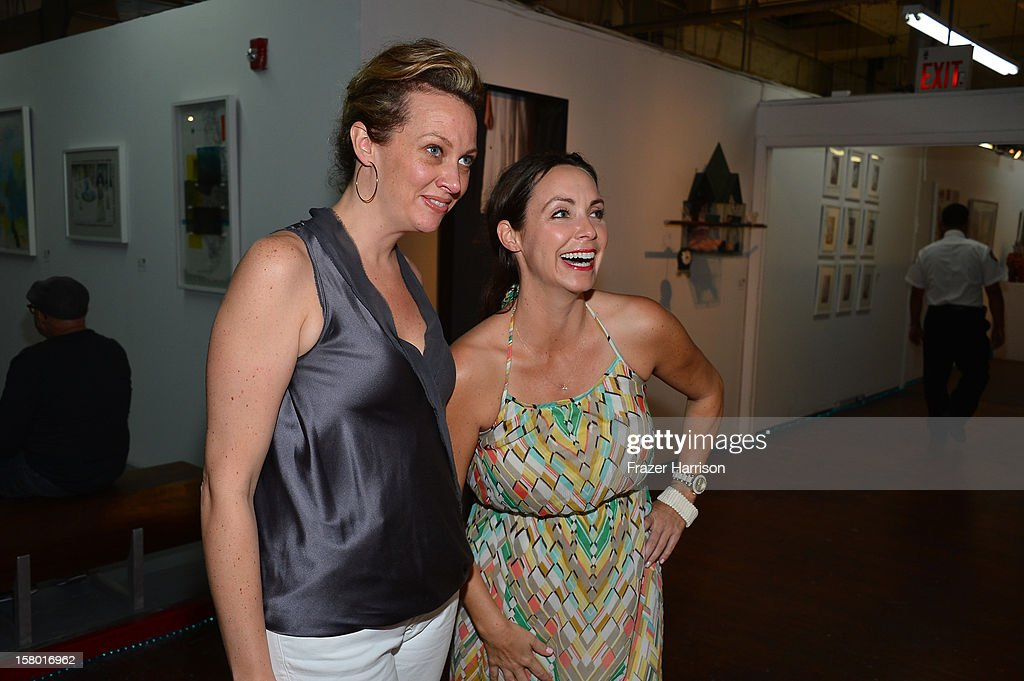 Designer Allison Raymond and volunteer Ali Schwarb attend the Art Miami after party at Bakehouse Art Complex on December 8, 2012 in Miami, Florida.