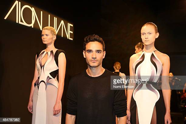 Designer Alon Livné poses at the Alon Livne fashion presentation during MercedesBenz Fashion Week Spring 2015 at The Hub at The Hudson Hotel on...