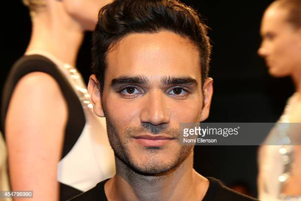 Designer Alon Livne poses at the Alon Livne fashion presentation during MercedesBenz Fashion Week Spring 2015 at The Hub at The Hudson Hotel on...