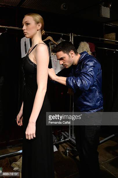 Designer Alon Livne poses with a model at the Alon Livne presentation during MercedesBenz Fashion Week Fall 2014 at The Hub at The Hudson Hotel on...