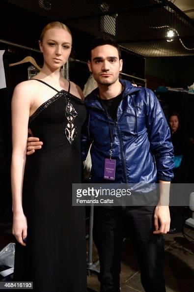 Designer Alon Livne poses with a model at the Alon Livne presentation during MercedesBenz Fashion Week Fall 2014 at The Hub at The Hudson Hotel on...