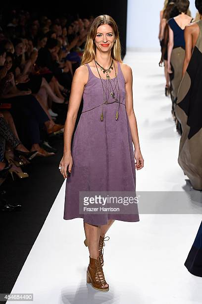 Designer Amanda Valentine walks the runway at the Project Runway fashion show during MercedesBenz Fashion Week Spring 2015 at The Theatre at Lincoln...
