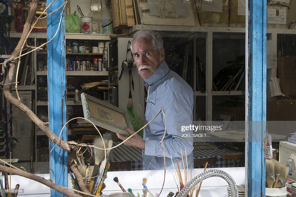 US designer and artist Joseph Hilton McConnico poses in his workshop in the Bagnolet suburb of Paris on April 26, 2013 before an upcoming exhibition. It may be because in the city 'shadows are sharper than in the countryside' that Hilton McConnico, 69, chose to install a field of flax 1,000 m2 near the Louvre Museum in Paris for the open air exhibition 'L'incroyable récolte' ('The incredible harvest') to be held from June 3 to 9.